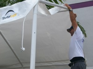 Porter Aryam Balsa helps anchor a canopy on the north side of the Off Lease Only Miami building.