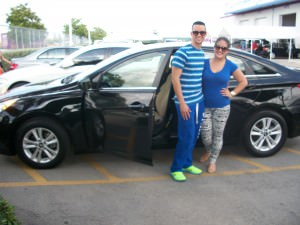 Alejandro Alsina and fiance Yemyle Gonzalez pose with the 2012 Hyundai they purchased for $12,999.
