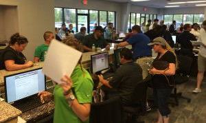 Customers fill the showroom at Off Lease Only Orlando on Opening Day.
