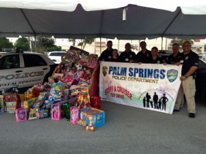 Palm Springs Police show off toys collected during last year's toy drive.