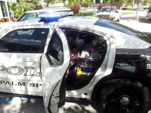 Palm Springs Police cruiser fills up with toys during last year's toy drive.