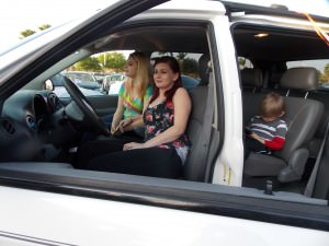 Heather Moorer sits in the drivers seat of her 2006 Chrysler mini-van, with son Tommy in the back.