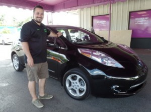 BDC Manager Devin DeVito shows off his 2013 Nissan Leaf