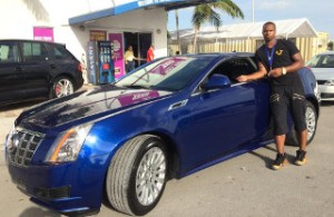 Tennessee Titans cornerback Ri'Shard Anderson shows off his 2012 OffLeaseOnly used Cadillac CTS Coupe.