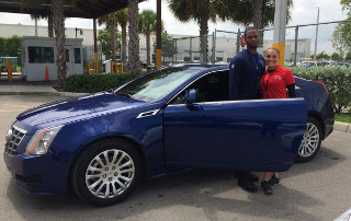 Tennessee Titans Cornerback Ri'Shard Anderson and OffLeaseOnly sales associate Amy Williams with Cadillac CTS.
