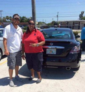OffLeaseOnly sales associate Russ Cosolito and customer Twanna White with her 2014 OffLeaseOnly Used Nissan Maxima