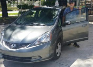 OffLeaseOnly customer Jorge Barocio with his used Honda Fit.