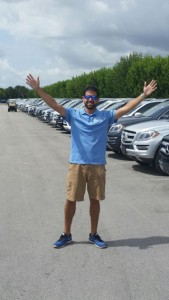 OffLeaseOnly Miami sales associate Kenny Alvarez shows off OffLeaseOnly's huge selection of luxury SUVs.