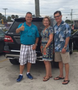 OffLeaseOnly Sales Associate Kory Drotar, with customers Pamela and Mark Thomas.