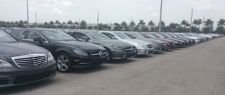 OffLeaseOnly used Mercedes inventory lined up outside dealership.