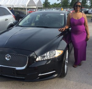 OffLeaseOnly customer Kimerly Laster with her pre-owned Jaguar XJ.
