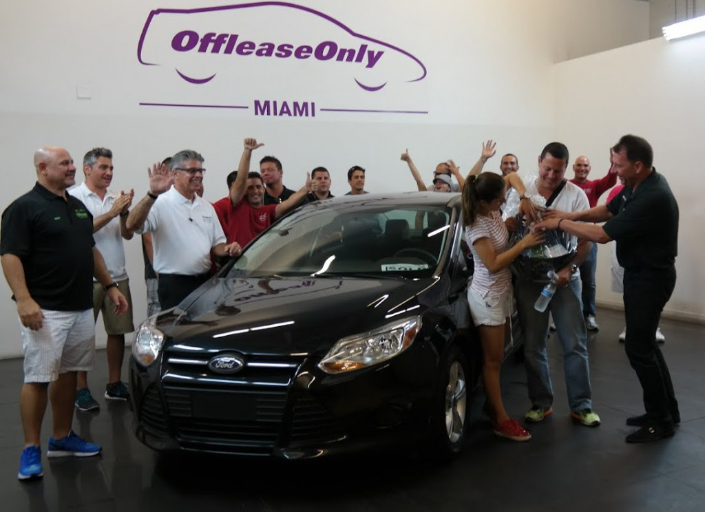 Hugo Trujillo-Penagos and his wife celebrate after being named OffLeaseOnly's