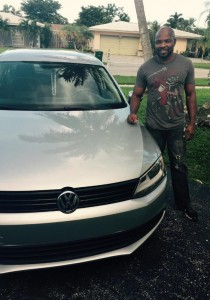 Tamarac resident Romel Bryan with his 2014 OffLeaseOnly used Volkswagen Jetta.