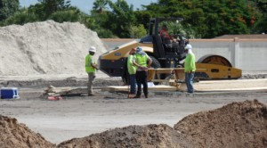 Construction workers discuss progress at OffLeaseOnly Palm Beach construction site at 1200 S. Congress.