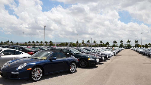 Hundreds of OffLeaseOnly used cars line an OffLeaseOnly car lot, awaiting sale.