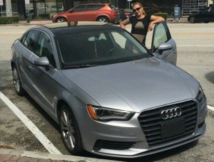 OffLeaseOnly customer Vitaliya Koroza of Hallandale Beach poses with her OffLeaseOnly 2015  Used Audi A3.