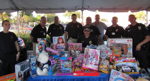 Palm Springs Police Springs display a cache of donated toys from the 2014 holiday toy drive. Officers are hoping to collect even more toys this year for children in need.